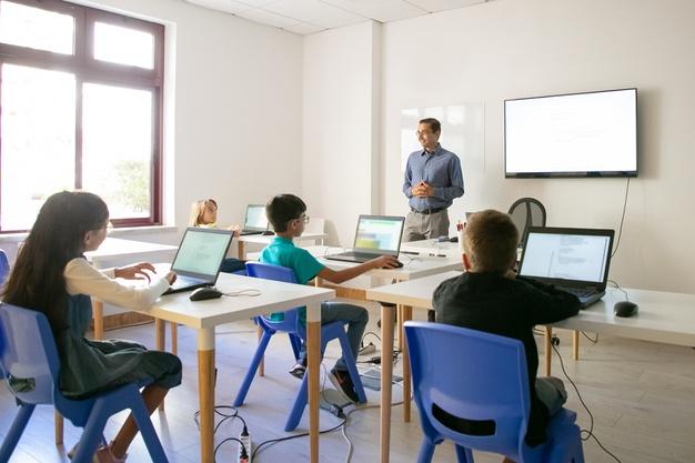 confident-teacher-explaining-lesson-pupils 74855-9751