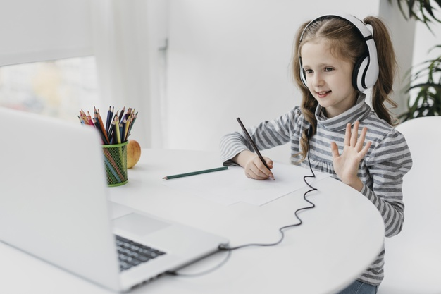 school-girl-wearing-headphones-virtual-school 23-2148771397